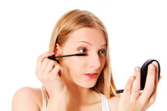 Attractive woman doing make-up on face. Isolated Royalty Free Stock Photos