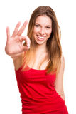 Attractive woman doing OK sign Stock Photo