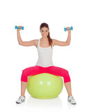 Attractive woman doing pilates with a big green ball Stock Images