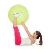 Attractive woman doing pilates with a big green ball Royalty Free Stock Photos