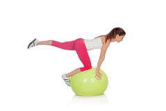 Attractive woman doing pilates with a big green ball Royalty Free Stock Photo
