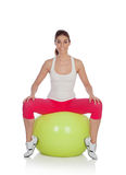 Attractive woman doing pilates with a big green ball Stock Photography