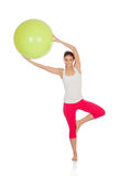 Attractive woman doing pilates with a big green ball Royalty Free Stock Images