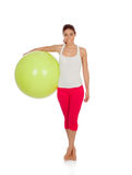 Attractive woman doing pilates with a big green ball Stock Photo