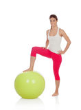 Attractive woman doing pilates with a big green ball Royalty Free Stock Photography