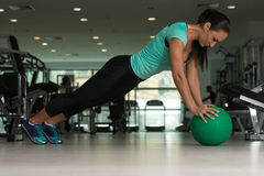 Attractive Woman Doing Push-ups On Floor In Gym Royalty Free Stock Images