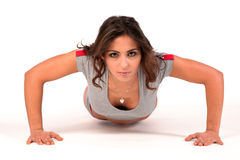 Attractive woman doing pushups Stock Photo