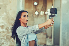 Attractive woman doing with selfie old home camera Stock Images