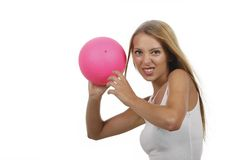 Attractive woman doing sports with a ball Stock Photo