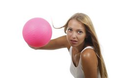 Attractive woman doing sports with a ball Royalty Free Stock Photo