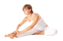 Attractive woman doing stretching Stock Images