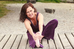 Attractive woman doing stretching exercises Royalty Free Stock Photos