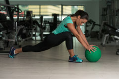 Attractive Woman Doing Stretching With Medicine Ball Royalty Free Stock Photos