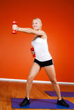 Attractive woman doing training exercise Royalty Free Stock Images