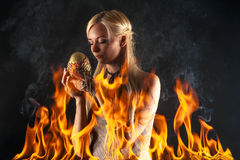 Attractive woman with a dragon egg in the fire Stock Photos