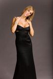 Attractive woman in dress. Attractive woman in black evening dress Stock Photos