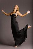 Attractive woman in dress. Attractive woman in black evening dress Stock Image