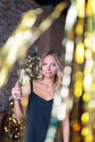 Attractive woman drinking champagne on the new Year`s party Royalty Free Stock Photos