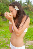 Attractive woman drinking coconut milk Stock Photos