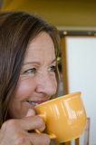 Attractive Woman drinking coffee Royalty Free Stock Photo