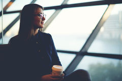 Attractive woman drinking coffee and waiting her husband Royalty Free Stock Photos