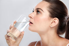 Attractive woman drinking a glass of mineral water Stock Photo