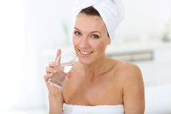 Attractive woman drinking glass of water Royalty Free Stock Images