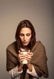 Attractive Woman Drinking a Hot Coffee Stock Image