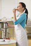Attractive woman drinking juice. Stock Photos