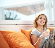 Attractive woman drinking refreshment outdoors Royalty Free Stock Photos