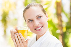 Attractive woman drinking tea Royalty Free Stock Images