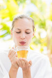 Attractive woman drinking tea Royalty Free Stock Photography