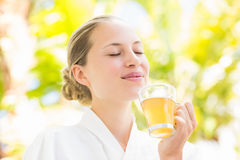 Attractive woman drinking tea Stock Images