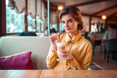 Attractive woman drinks a cocktail from the straw Stock Photography