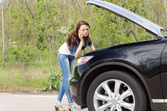 Attractive woman driver calling for assistance Stock Photography