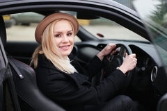 Attractive woman driver in her car Royalty Free Stock Images