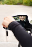 Attractive woman driver with her car keys Royalty Free Stock Photo