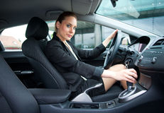 Attractive woman driving car Stock Images