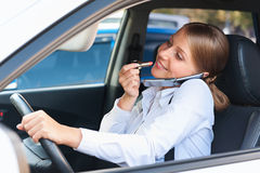 Attractive woman driving the car Stock Image