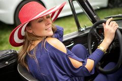 Attractive woman driving a classic car Stock Photo