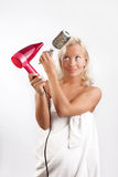 Attractive woman drying her blond hair Royalty Free Stock Photo