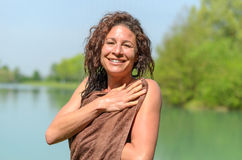 Attractive woman drying herself after swimming Stock Image