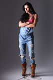 Attractive woman in dungarees. Royalty Free Stock Photo
