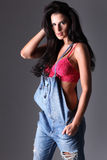 Attractive woman in dungarees. Royalty Free Stock Image