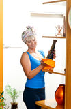 Attractive woman dusting royalty free stock photos