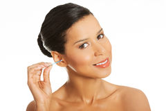 Attractive woman with ear stick. Stock Photo