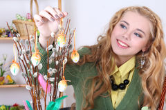 Attractive woman with easter eggs and pussy-willow. Young attractive woman with easter eggs and pussy-willow Stock Image