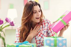 Attractive woman with Easter presents. Picture showing attractive woman preparing Easter presents at home Stock Images