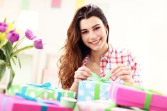 Attractive woman with Easter presents. Picture showing attractive woman preparing Easter presents at home Stock Photo