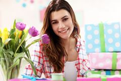 Attractive woman with Easter presents. Picture showing attractive woman preparing Easter presents at home Stock Photography